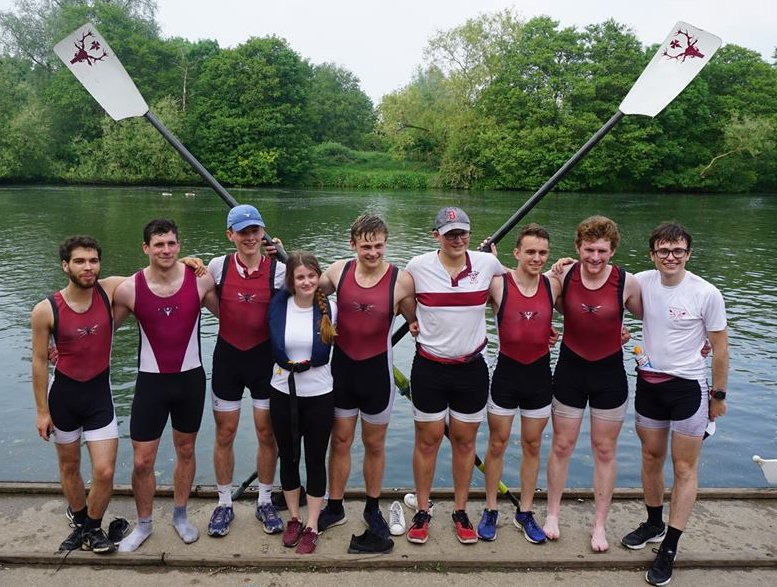 Hertford student rowers standing by the river
