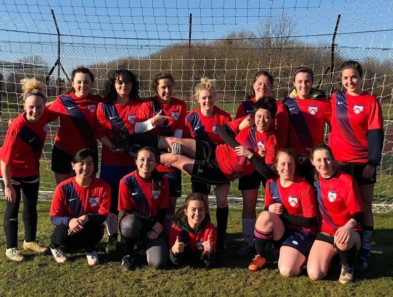 Women's football team posing for group photo